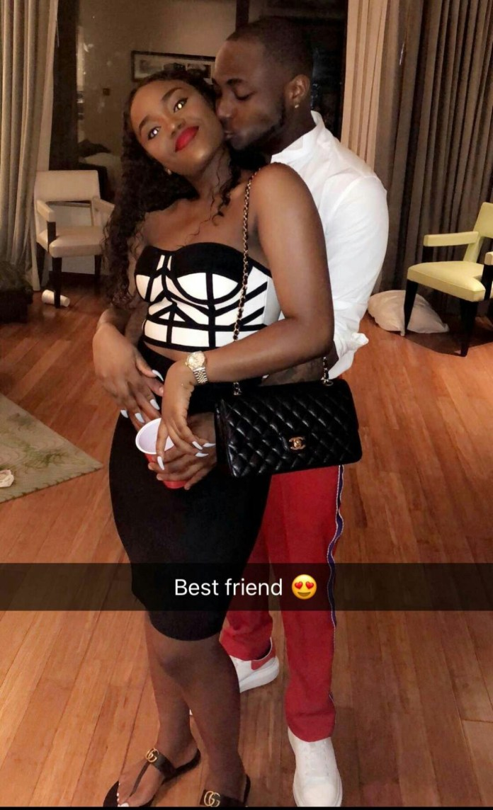 Cute photo of Davido holding and kissing his girlfriend, Chioma in London! And she