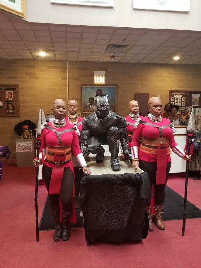 Criticism as pastor and his choristers make grand entrance into church in Black Panther
