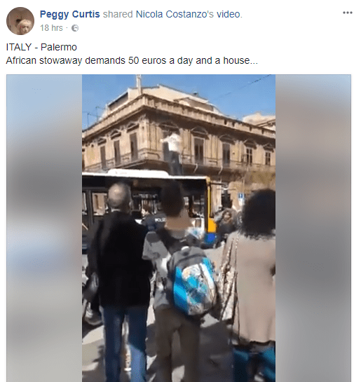 Nigerian immigrant climbs on top of a bus in Italy and threatens to kill himself if they don