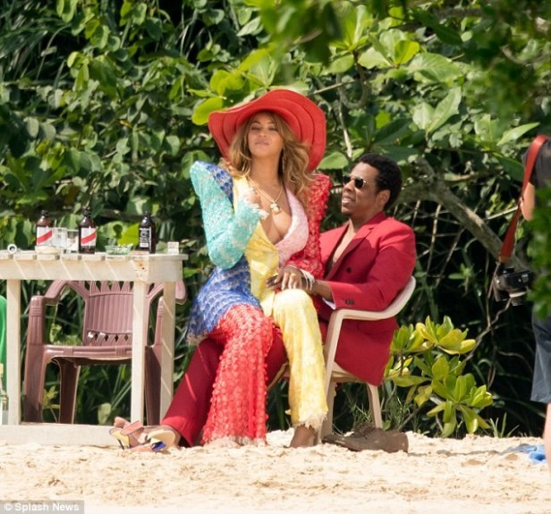Power couple! Beyonce flaunts major cleavage in jumpsuit as she sits on Jay-Z