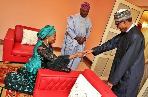 Photo: First Lady of Lagos, Bolanle Ambode kneels down to greet President Buhari