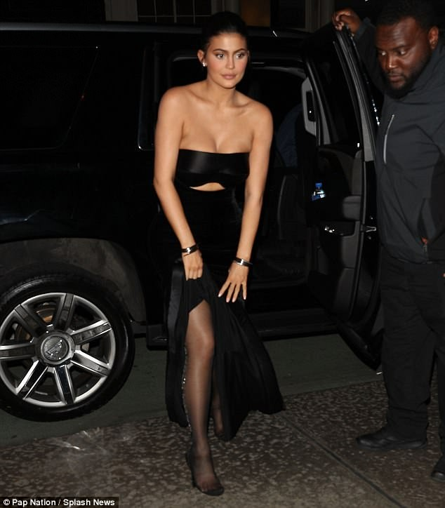 Kylie Jenner returns to the red carpet in peekaboo dress with boyfriend Travis Scott at Met Gala