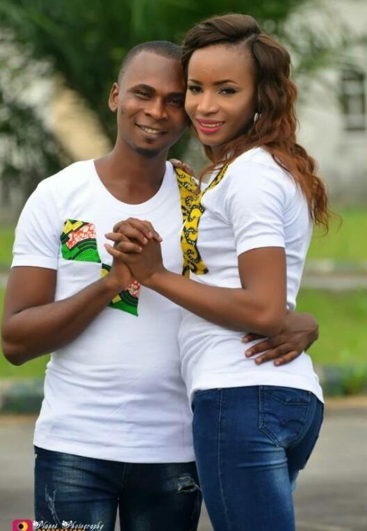 Nigerian man looks underneath his fiancee