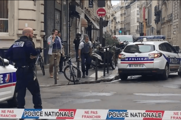 5b1fe5d68359c - Paris street locked down as a man held 2 persons hostages.
