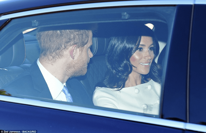 Meghan Markle looks regal as she joins Prince Harry and The Queen for a star-studded reception in Buckingham Palace