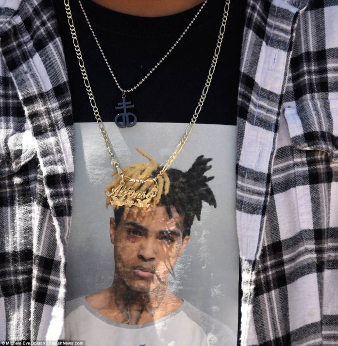 Heartbreaking photos of XXXTentacion fans crying at his six-hour open-casket memorial at 20,000 seat Florida arena