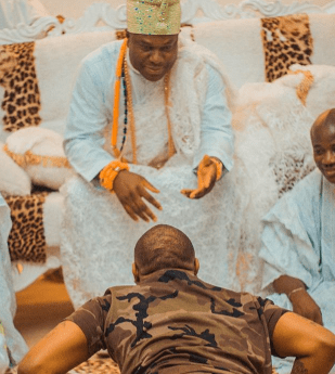 Davido goes flat on the ground as he pays Ooni of Ife a courtesy visit(photos)