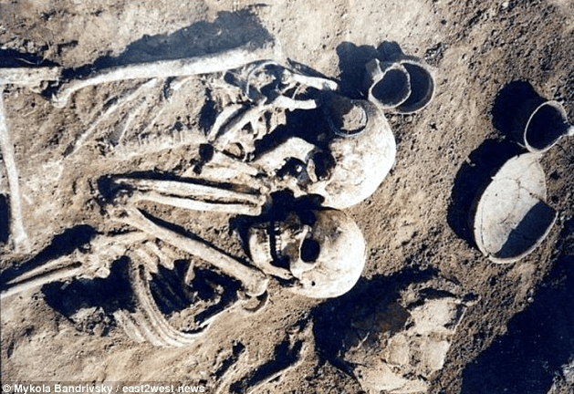 Man and woman found together in Ukrainian grave after she was buried alive with her dead husband