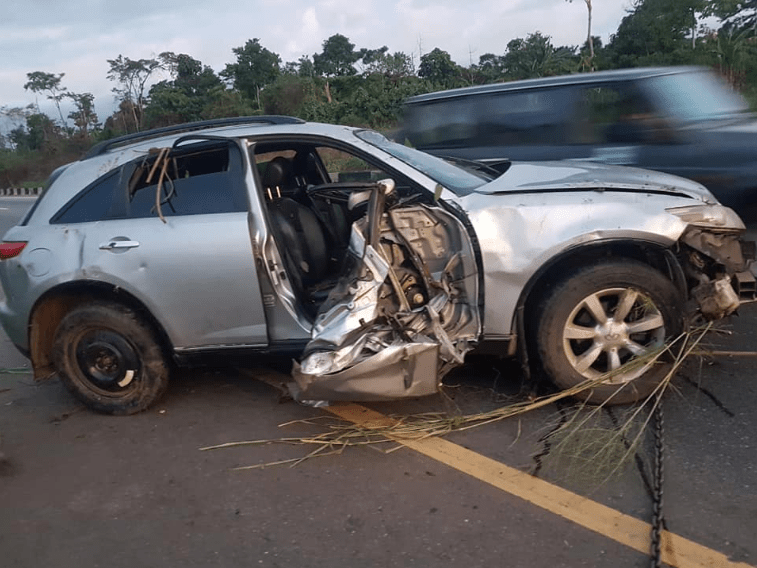 Man climbs his overturned car to take photos after he survived ghastly accident in Ondo state