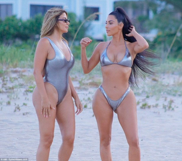 Kim Kardashian flaunts her banging body in sexy silver bikini as she poses in Miami beach (Photos)