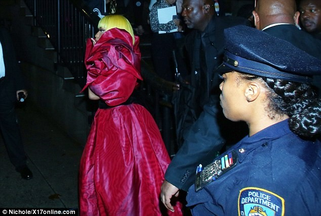 See how security entourage surrounded Nicki Minaj at Marc Jacobs show following brawl with Cardi B ?(Photos)
