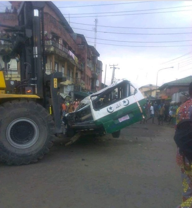 Driver killed as truck conveying tomatoes falls on bus in Lagos
