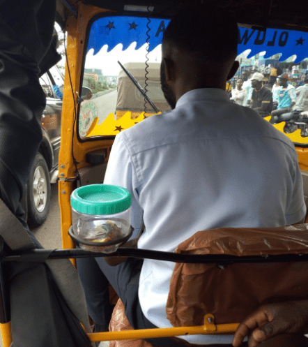 """""""Corporate keke driver"""" who has sweets and his business card in his tricycle for passengers goes viral (photos)"""