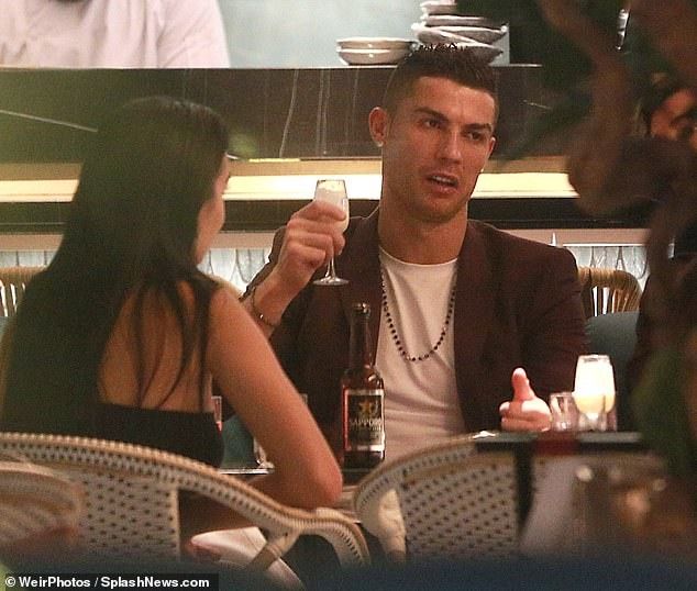 [Photos] Cristiano Ronaldo treats his girlfriend and son to a London dinner date
