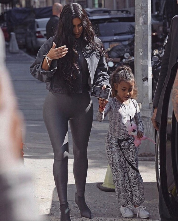 Stylish North West steps out with her mother in a snakeskin jumpsuit