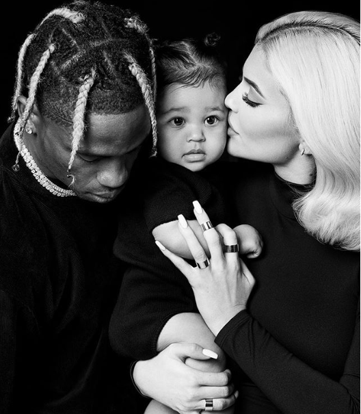 Adorable family photo of Kylie Jenner and Travis Scott posing with their baby daughter Stormi in matching black outfits for Thanksgiving