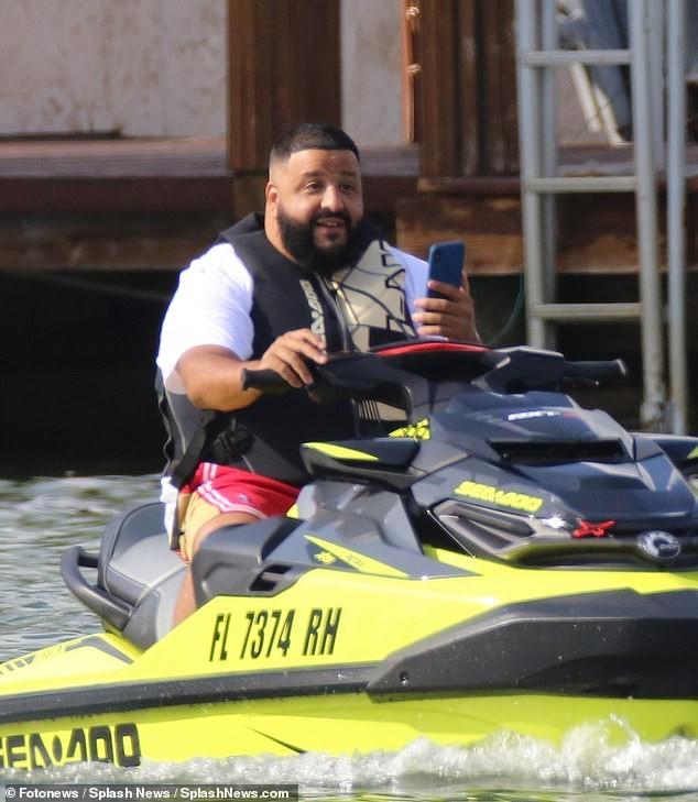 DJ Khaled and his wife Nicole Tuck ride jet skis around Miami on his 43rd birthday (Photos)