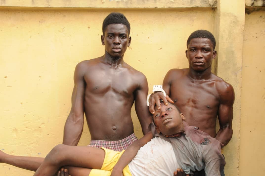 Graphic Photos: Two brothers arrested with the head of their neighbour they beheaded for ritual
