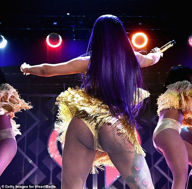 Cardi B puts on a very busty display as she flaunts her backside on stage (Photos)