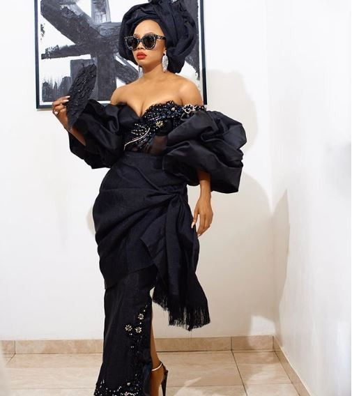 Those boobs are crying for help - Nigerians react to Toke Makinwa's revealing outfit to the premiere of 'Chief Daddy'