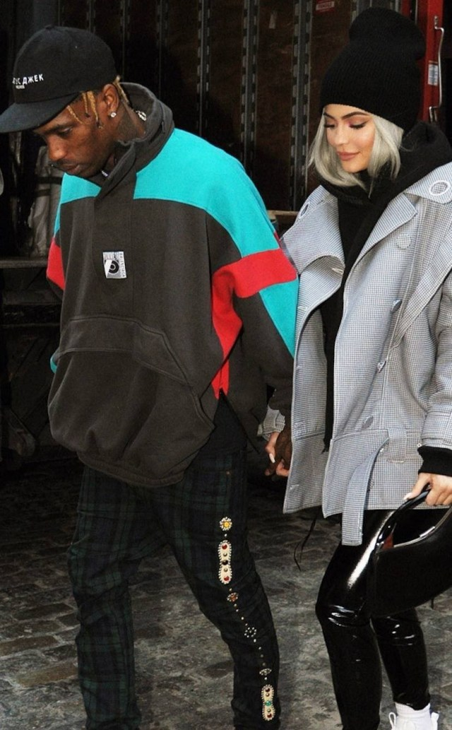 Travis Scott denies cheating rumors after someone who looks exactly like him was photographed cuddling a woman who isn