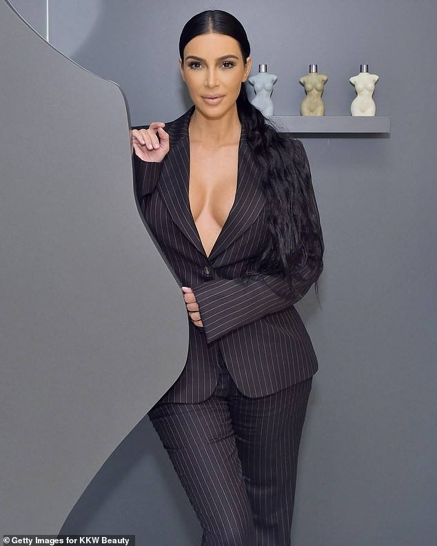 Kim Kardashian flaunts her cleavage in oversize matching suit as she opens pop-up shop in Southern California (Photos)