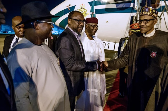 Image result for Buhari from back from Poland images