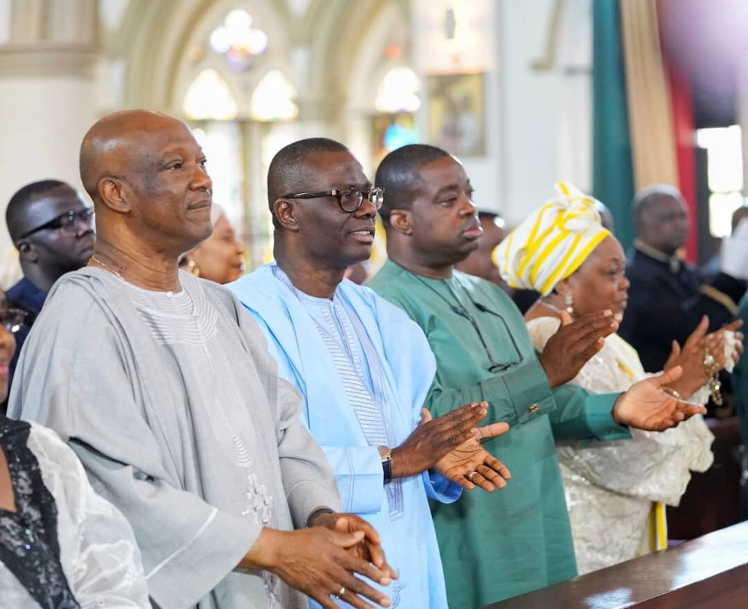 PDP and APC Lagos governorship candidates Jimi Agbaje and Jide Sanwoolu pictured together in church on New Year Day (Photos)