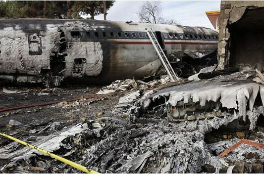 Photos: Military cargo plane crashes in Iran killing at least 15 people