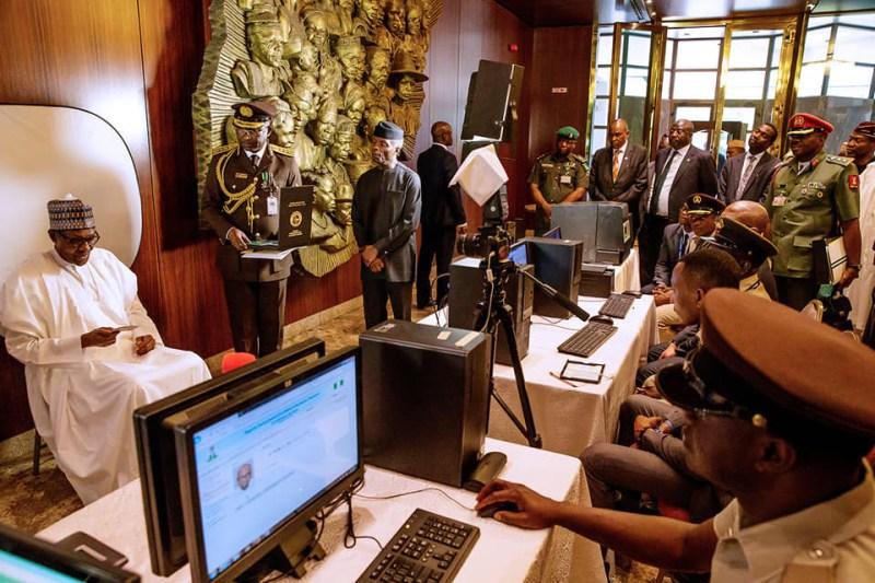 President?Buhari unveils new Nigerian International?passport with 10-year validity