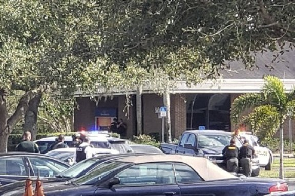 Man who stormed Florida bank and massacred five people has been named