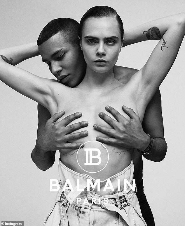 Cara Delevingne goes topless with Balmain?s creative director Olivier Rousteing covering her boobs (Photos)