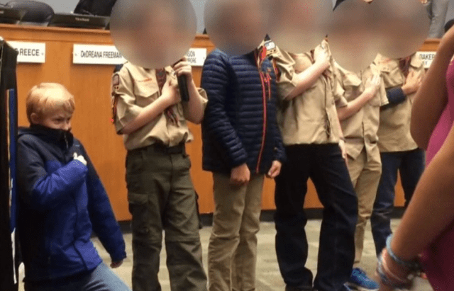 10-year-old Cub Scout goes viral after he takes a knee during the Pledge of Allegiance at a city council meeting (video)