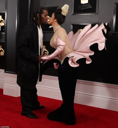 Cardi B and Offset go tongue-to-tongue on the Grammys red carpet