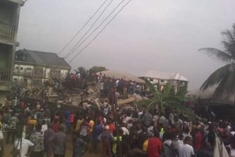 Photos/Video: One dead, another trapped as two 3-storey buildings collapse in Aba