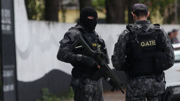 8 dead as two former students carrying guns open fire on students in Brazil
