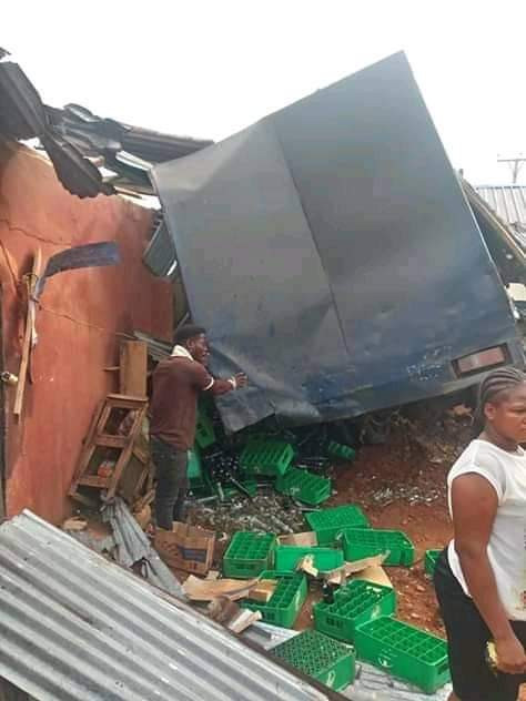 Photos: Trailer loaded with crated of drinks crashes into hotel in Anambra