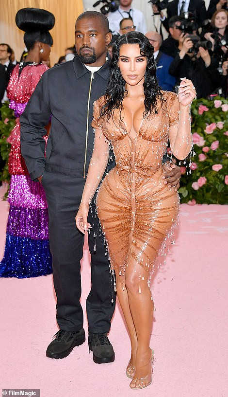 Kim Kardashian puts her curves on display as she arrives the Met Gala in figure-hugging Maison Mugler gown