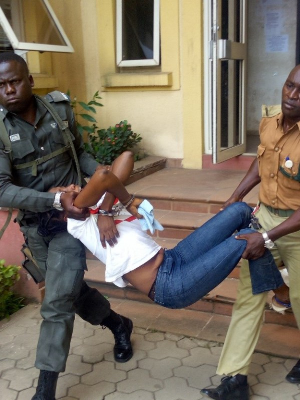 Photo: Woman collapses and carried out of court after being sentenced to death for killing her neighbour during fight in Ajegunle, Lagos