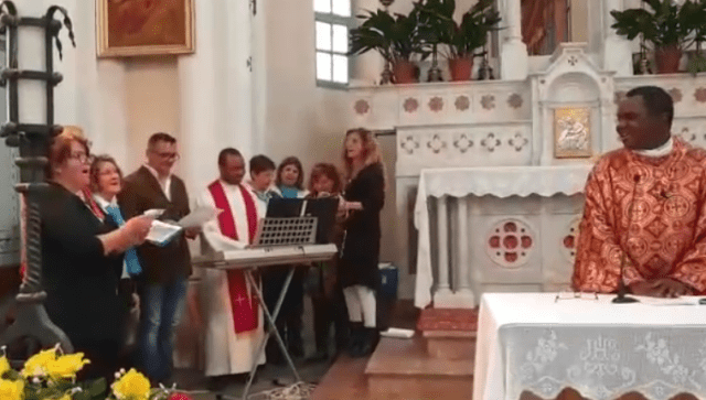 Video: Nigerian priest in Switzerland breaks down in tears after his parishioners sang him an Igbo song to celebrate his priestly anniversary
