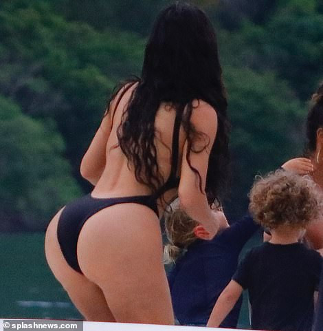 Kim Kardashian flaunts her famous backside in skimpy black swimsuit during boat day in Costa Rica (Photos)