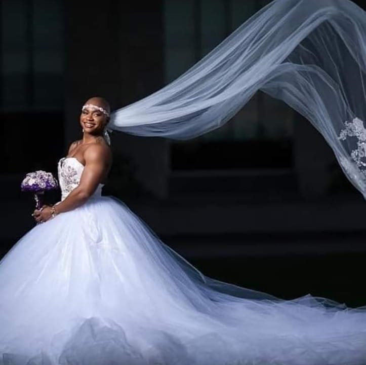 Female bodybuilder with prominent muscles goes viral as she weds (Photos)