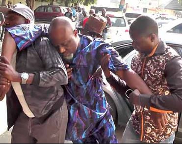 Senator Dino Melaye unable to 'stand' at the resumed hearing of his criminal trial