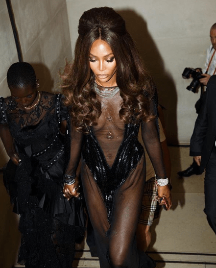 Naomi Campbell flashes her boobs in sheer low cut gown at London Fashion Week