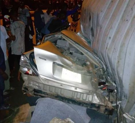 Fallen container crushes two people to death, injures many others in Lagos