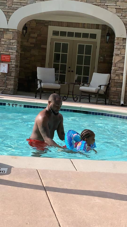 Photos/Video: Davido goes swimming with his second daughter, Hailey
