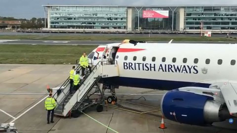 Blind paralympic climbs on top of a plane about to take off as he protests government inaction on climate change