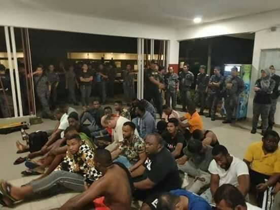Nigerians arrested and deported by Indonesian government for allegedly spraying money during Pastor Odumeje?s visit (video)