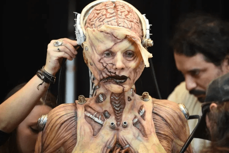Heidi Klum beats her previous record as she reveals her gory Halloween costume after 13 hours of prosthetics