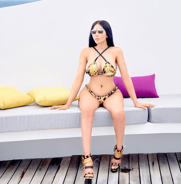 Dencia poses in Versace bikini and Christian Dior sandals (Photos)
